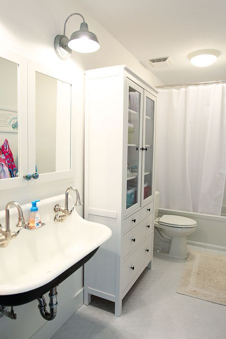 white hex tile on the floor white subway tile in the shower two more barn lights above the sink which is a kohler brockway sink ikea hemnes cabinet and